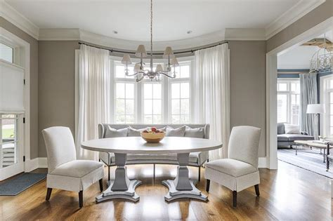 oval pedestal dining table  bay window transitional