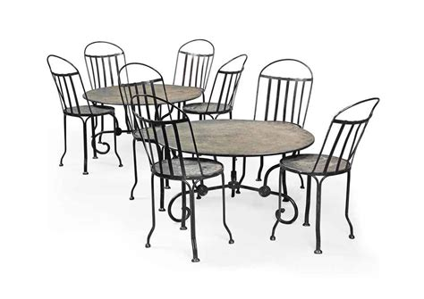 a set of eight cast iron dining chairs and a pair of cast