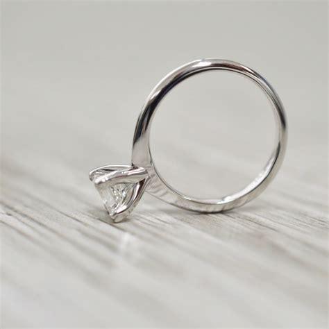 princess in a v corner knife edge flush engagement ring in white
