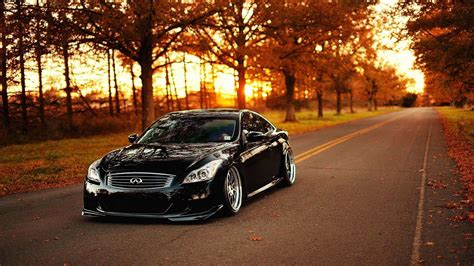 beautiful black car   road autumn season