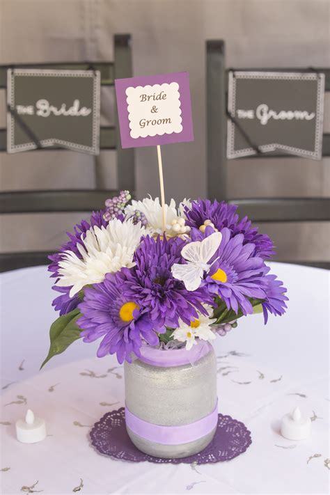 centerpiece purple daisies  butterfly wedding recycle