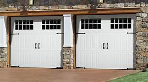 Openings in carriage house style looks can be deceiving for Carriage style garage doors prices