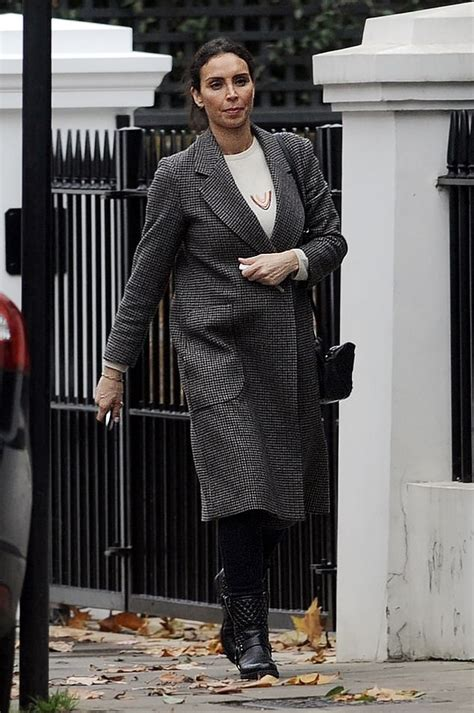 Christine Lampard cuts a chic silhouette in a long gray ...