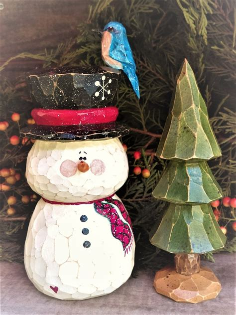 hand carved snowman  carved tree  images