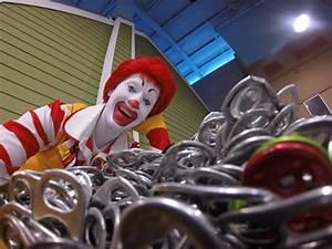 Ronald McDonald looking at pop tabs - Ronald McDonald