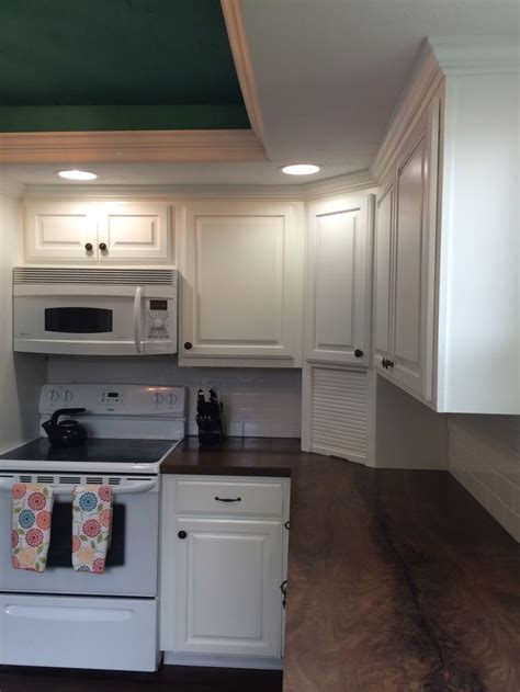 white formica kitchen cabinets kitchen with white cabinets white subway tile and 1302