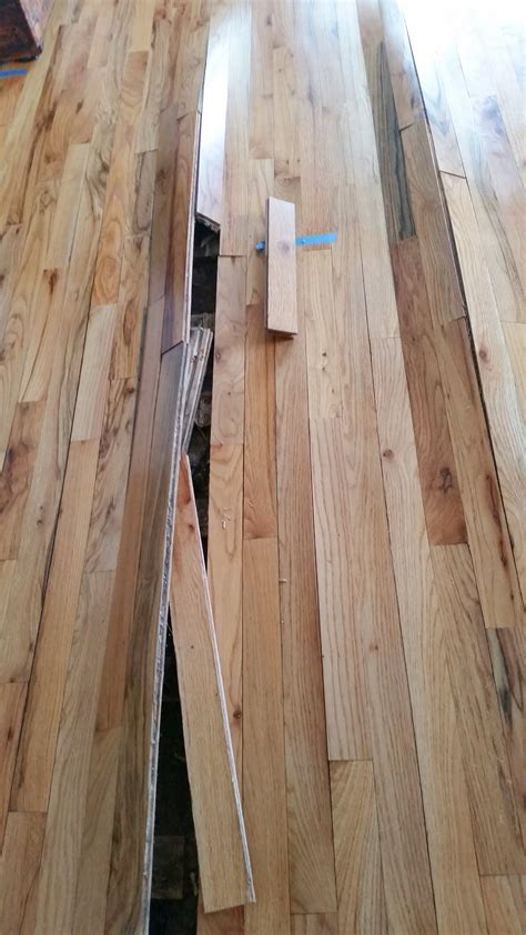 Wood Floor Cupping Water Damage by Repairing Water Damaged Hardwood Floors Mr Floor Chicago