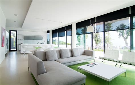 b home interiors interior minimalist design of living room with gray chaise lounge and large picture windows
