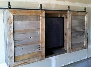 Outdoor tv cabinetthe barn doors might be a good idea for Barn door tv wall cabinet