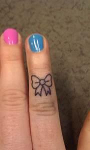 Bow Finger Tattoos | www.imgkid.com - The Image Kid Has It!