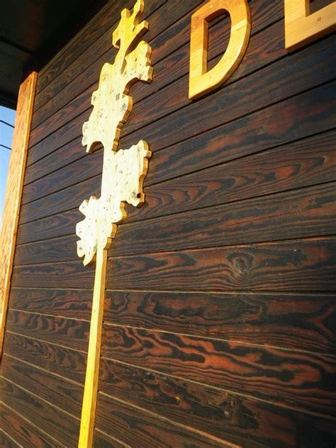 Delta Bathroom Lighting by Shou Sugi Ban Burnt Wood Siding
