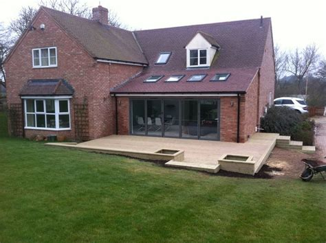 single storey extension concertina doors decking open
