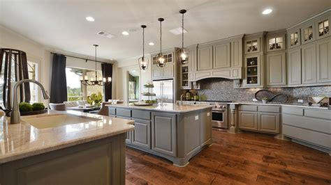 white kitchen island granite top wood vent hoods burrows cabinets central builder direct custom cabinets
