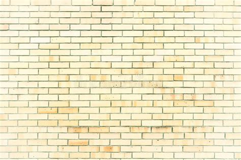 texture stone background of light yellow brick wall