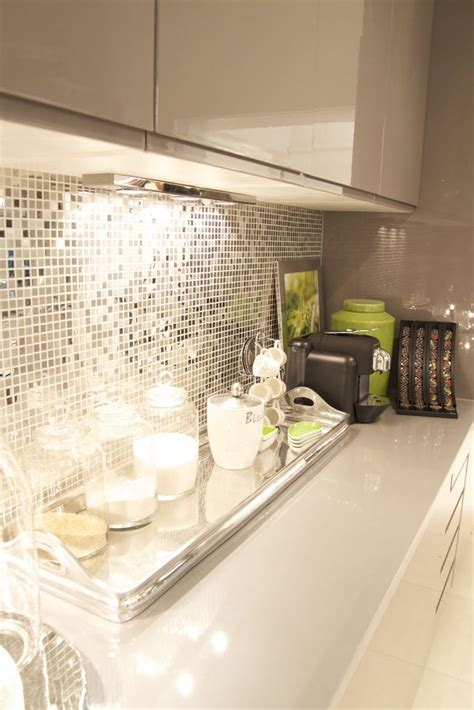 Cream And Gray Kitchen With Reflective Backsplash This Is