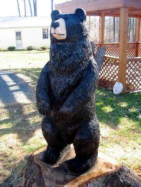 hand crafted large black bear wood sculpture  sleepy