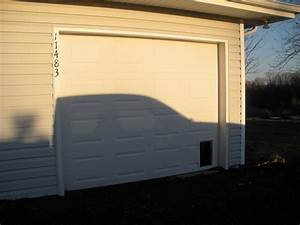Pin by duffy russell on repurposed garage new living for Dog door for garage door