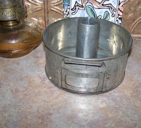 vintage swans  flour advertising tube cake pan