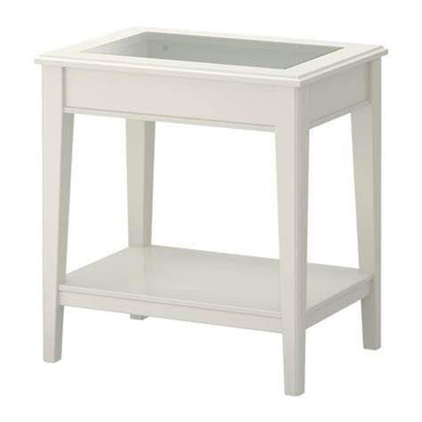 It also features a bottom shelf that can be used to keep newspapers, magazines, and other daily use items. LIATORP Side table - white/glass - IKEA