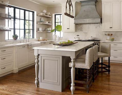 center island kitchen transitional kitchen features an iron linear chandelier