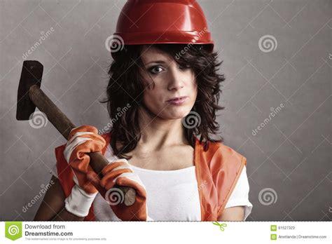 Girl In Safety Helmet Holding Hammer Tool Stock Image