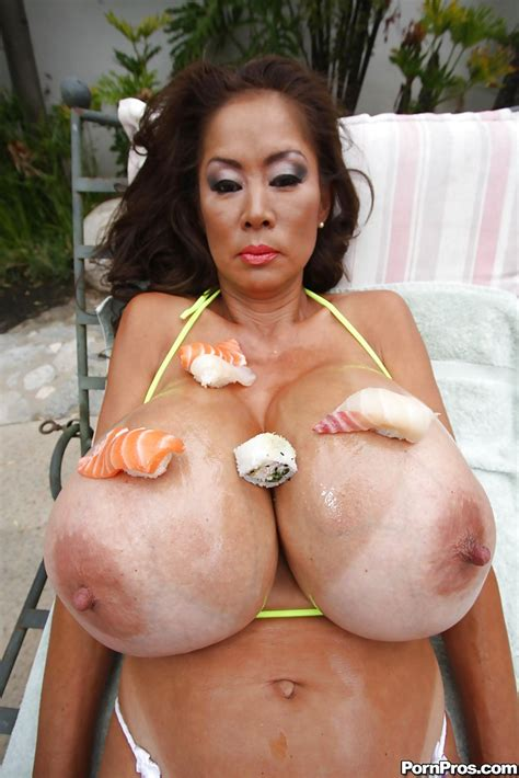 Asian Mom With Huge Tits Minka Exposing Her Melons In