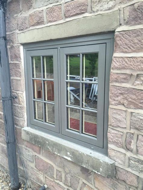 hms developments installation  painswick coloured residence  windows home window grill