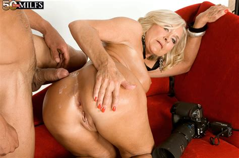 hot Older blonde Katia Seduces A Younger Guy With Her Big Tits Out
