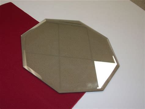 "Mirror Tile, Hexagon 8""   Uptown Rentals"