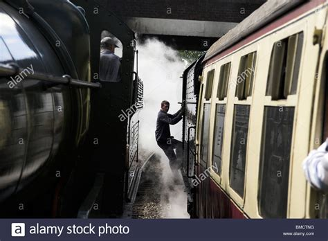Steam Engine Driver Stepping Down From His Train At