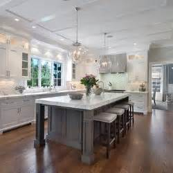 gray kitchen island lovely kitchen features a darlana large lantern hanging a gray kitchen island topped with