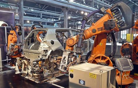 chinese factory replaces   human workers  robots