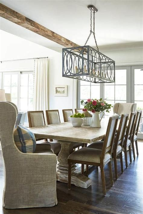 rustic cottage dining room boast  whitewashed trestle
