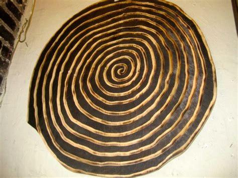 sold vertigo inducing spiral carved  burnt spiral