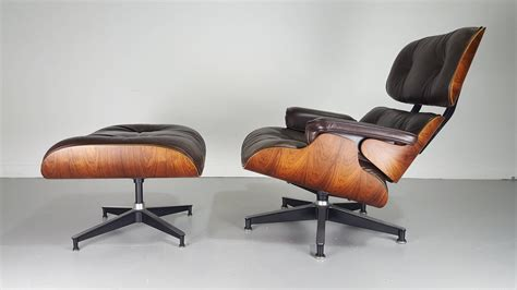 iconic eames lounge chair and ottoman in brown leather and