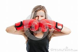 Female boxer touching red boxing gloves