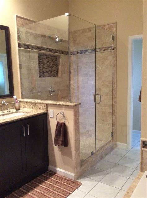 newly remodeled stand  shower  beautiful tile work