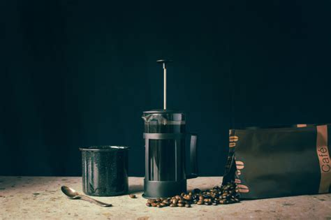 I've been in a constant battle trying to titrate the perfect cup of coffee. Premium Photo | French press, coffee beans and cup
