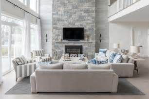 grey livingroom blue and gray living room with a two story fireplace transitional living room