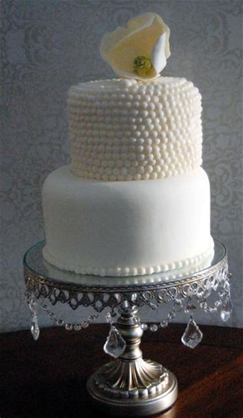 tier white  wedding cake  pearl beaded