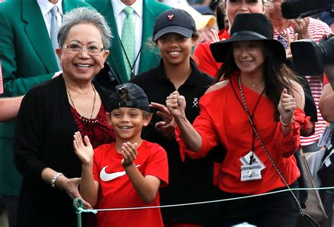 Tiger Woods joined by Erica Herman, kids and mum on ...