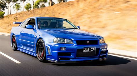 nissan skyline gt   blue color black wheels red