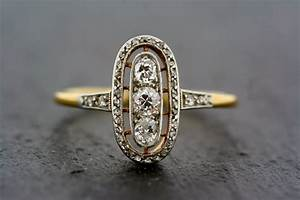 Vintage era inspired engagement ring designs for fiancee for Art deco antique wedding rings