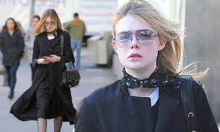 Elle Fanning dons oversized tinted glasses as she goes for ...