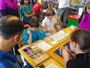 Kids choose their own work in a Montessori classroom