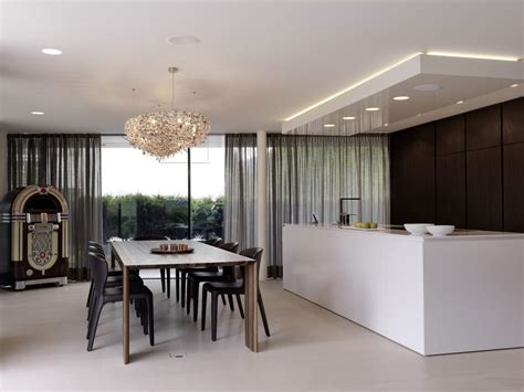 modern kitchen and dining room design onstage house designed by simmengroup keribrownhomes 9757