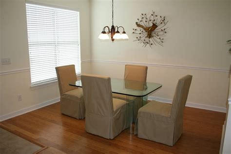 formal dining with beautiful banboo flooring crown and