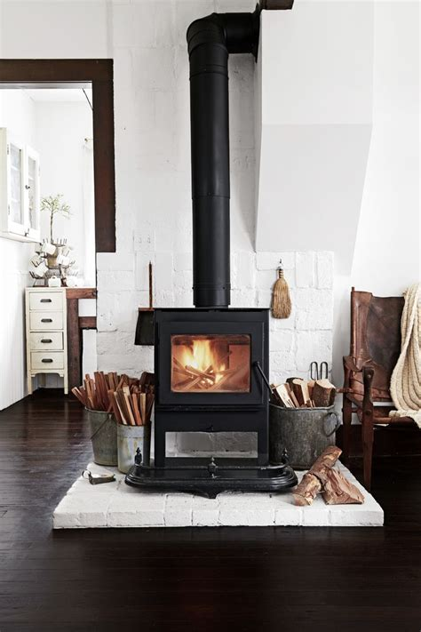 wood burning stove with white brick   Rustic Modern