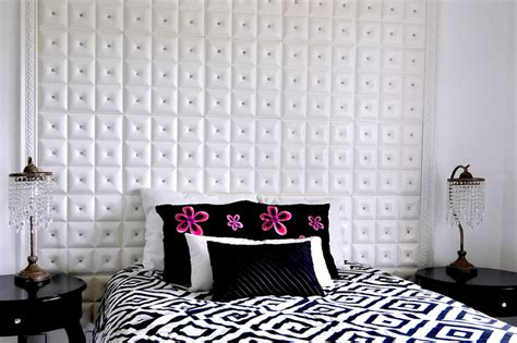 white faux leather ceiling tiles made into a headboard at