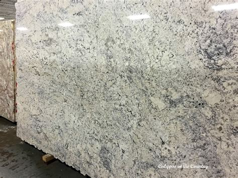 White Cabinets Dark Grey Countertops by Granite Obsessing Calypso In The Country
